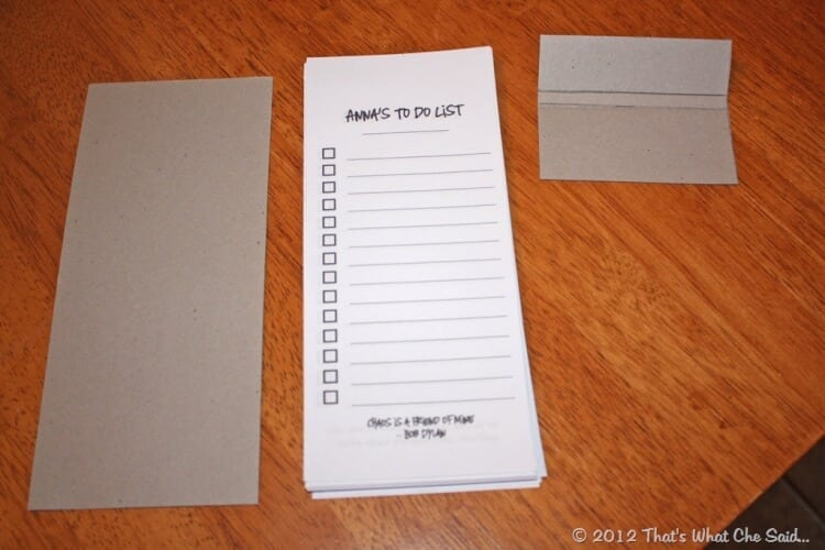 Pieces of Note Pad:  Cardboard backing, paper sheets trimmed to size (75) and cardboard topper