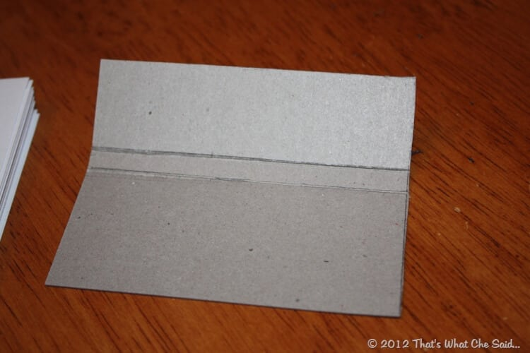 close up showing how to score the cardboard to get crisp bends/folds