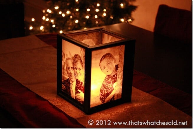 A picture frame luminary illuminated and at night. Glowing.