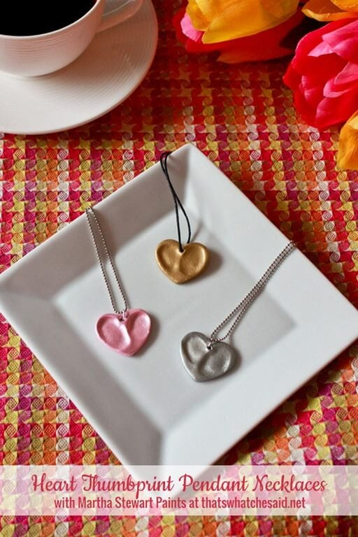 Three thumbprint heart necklaces made from oven bake clay and metallic paint.