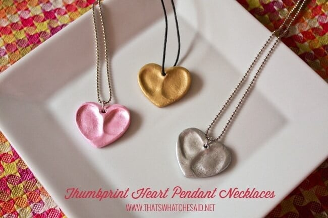 Heart charms made from oven bake clay and impressed with thumbprints to create the perfect keepsake
