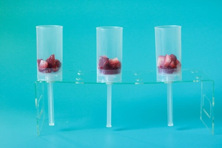 Add Strawberries to push pop containers for first layer