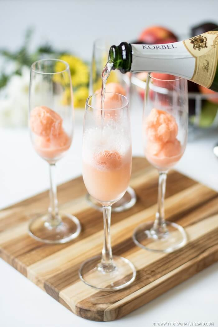 Pour Champagne on top of sherbert scoops