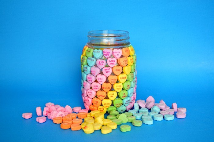 Mason Jar covered in Candy Hearts in Rainbow order