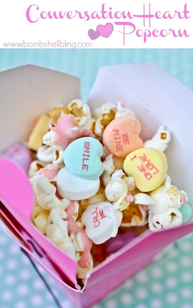 Popcorn Treat mixed with conversation hearts in a Chinese to go box