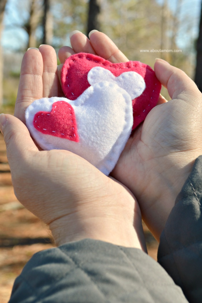 Hands holding heart hand warmers
