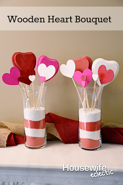 Wooden hearts on sticks grouped in a vase as a bouquet