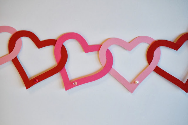 Interlocking paper hearts made into a garland