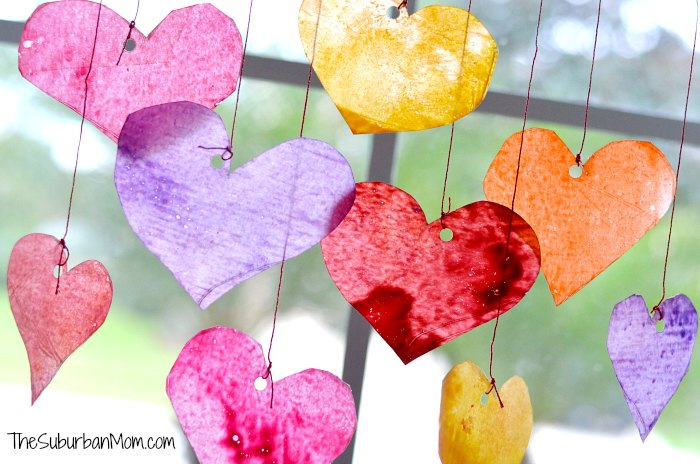 diy heart suncatchers in front of a window