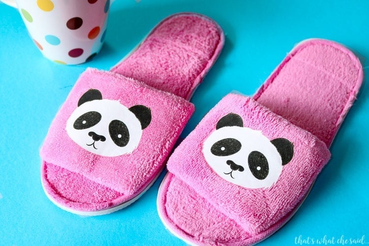 Slippers with Cricut Iron On Designs applied. Pandas on pink slippers
