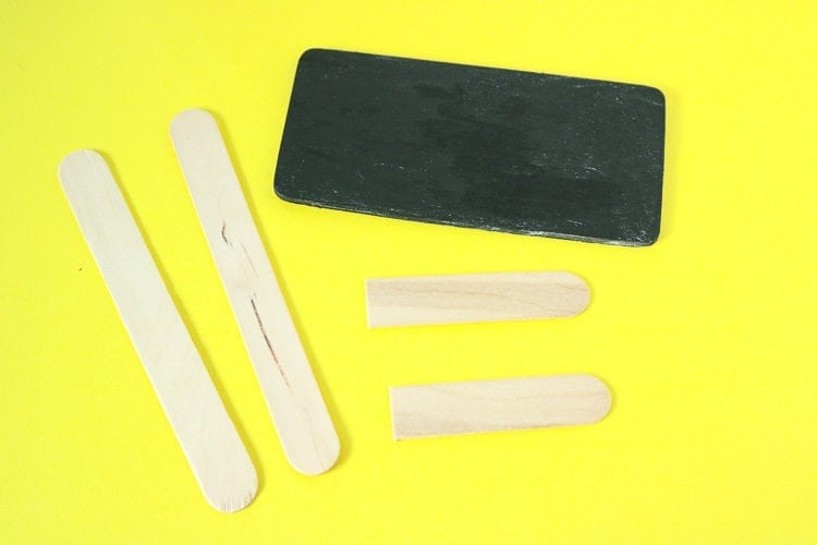 small chalkboard painted rectangle with popsicle sticks