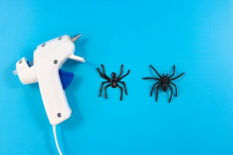 Hot glue gun with hot glue spider and fake spider