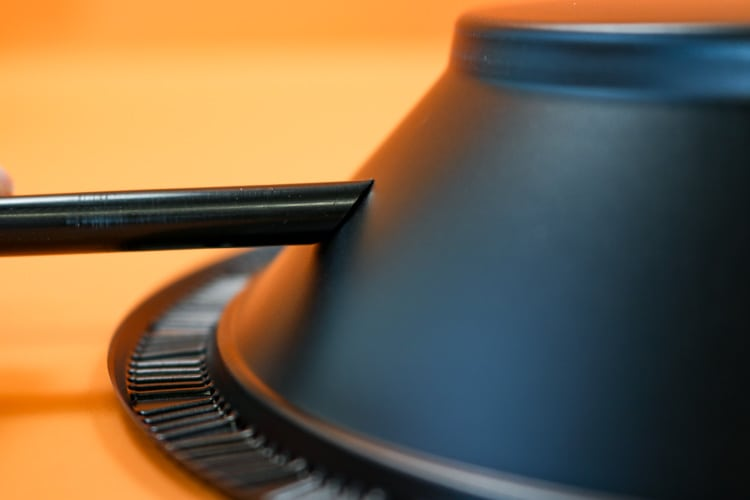 Visual of snipped straw fitting up against the angle of a bowl