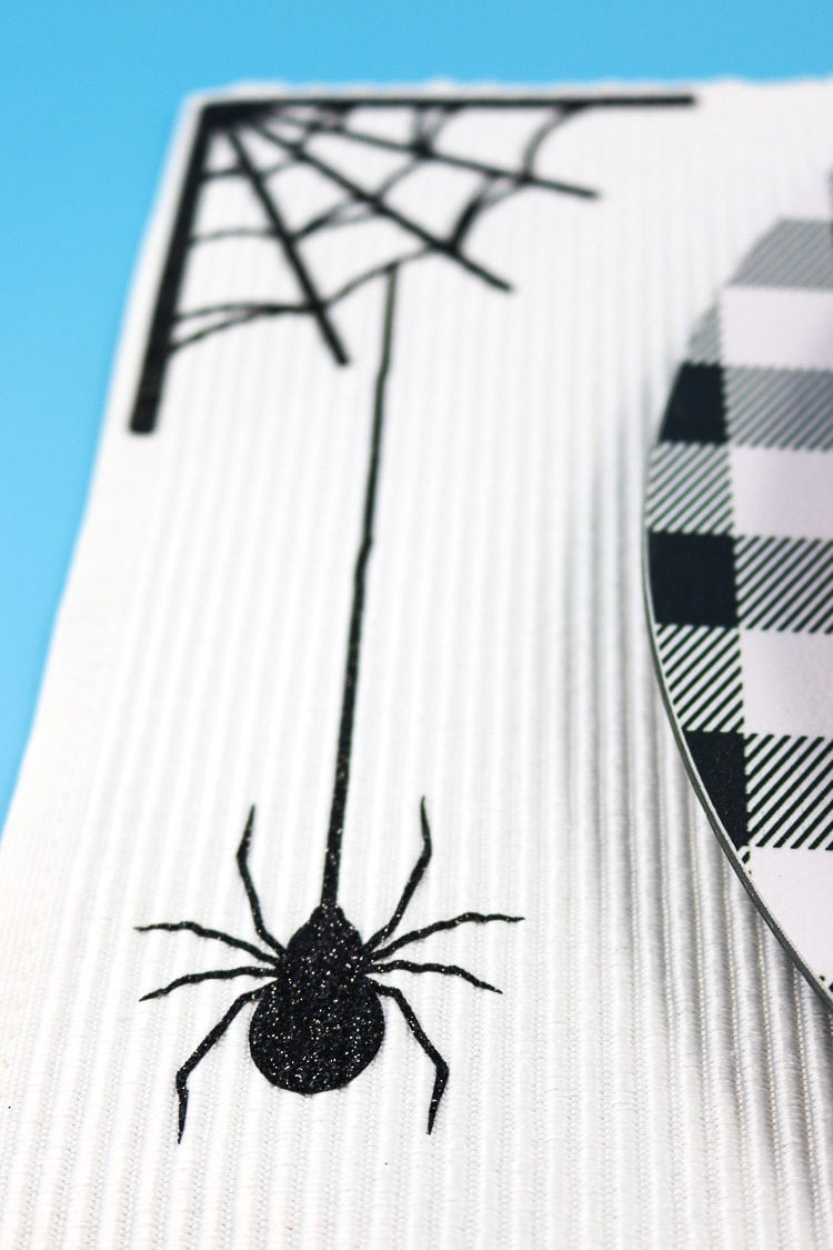 White Placemat with Spider Web & Hanging Spider in black glitter iron-on