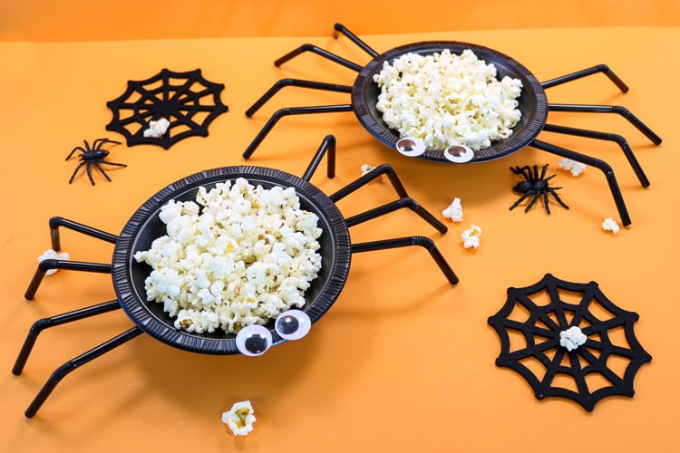 Spider bowls made from plastic bowls and straws filled with popcorn