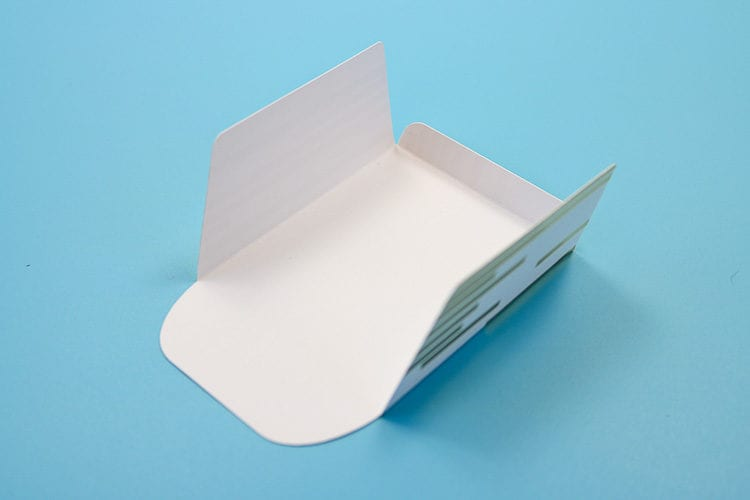 Cardstock Envelope that has folds along the score lines