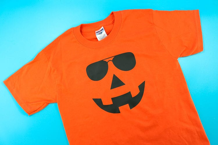 Orange Shirt with Jack-O-Lantern Face wearing Sunglasses