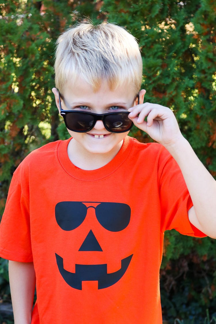 Boy sporting Orange Jack-o-lantern Shirt with sunglasses on