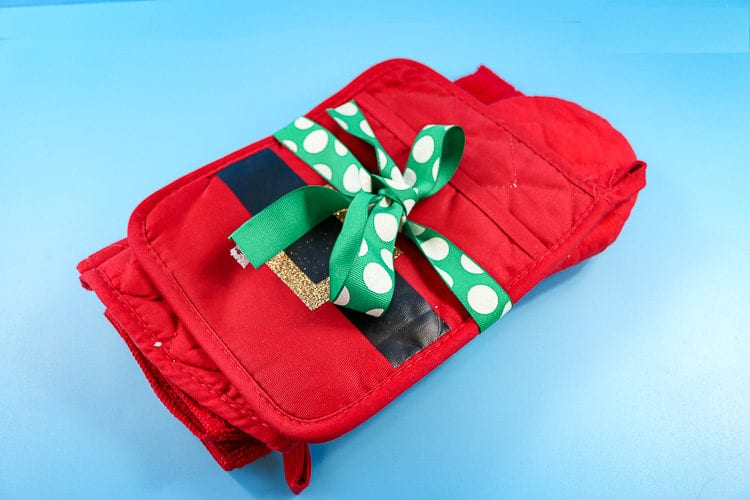Hot Pad, Oven Mitt and Dish Towel wrapped up with a ribbon perfect for an inexpensive gift idea
