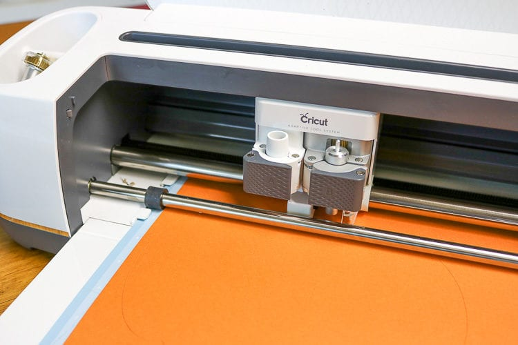 Cricut with Orange Cardstock loaded