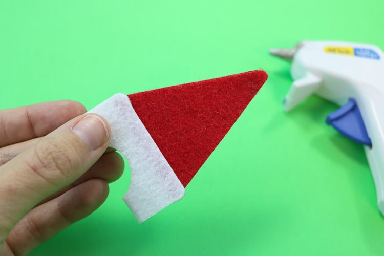 Second Santa Hat Assembly Step is to glue the red triangle tips together