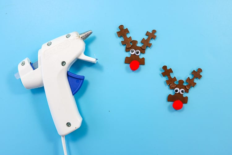 Reindeer Puzzle Pieces with Red Pom Pom Nose