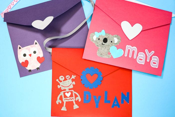 Three Large Envelopes made with the Cricut Maker to use as Valentine Boxes to collect class Valentines