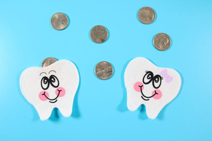 Two Tooth Pouches with Quarters in them