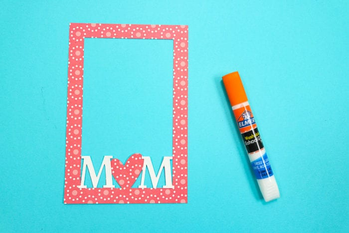 M letters added to the paper frame with elmer's glue