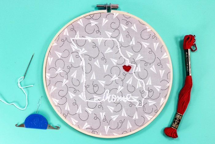 Finished Embroidery Hoop Project with patterned fabric backing