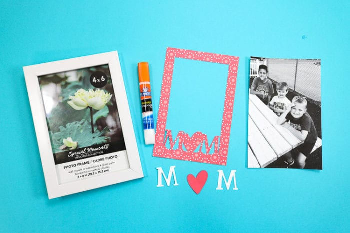 Frame, glue and cut pieces of scrapbook paper
