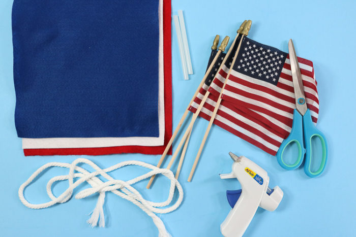 4th of July Banner Supplies: Felt, Small Flags, Rope, Scissors and A hot glue gun with glue sticks