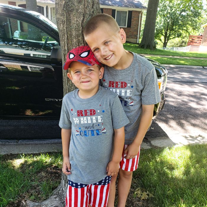 Brothers wearing red white and cute matching 4th of July shirts