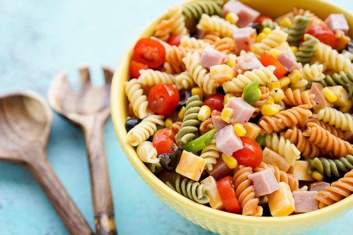 Bowl of Easy Pasta Salad with Utensils