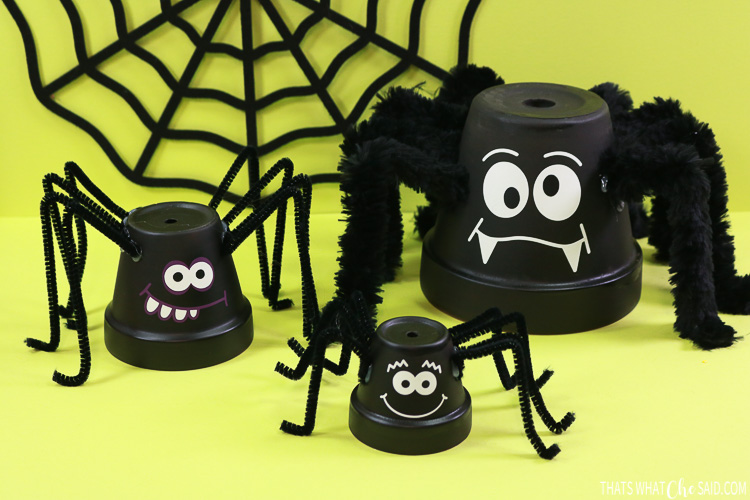 Three clay pots turned into spider halloween decor