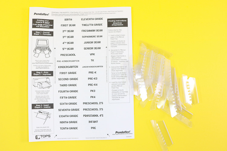 Printed sheet of tabs with plastic tab inserts