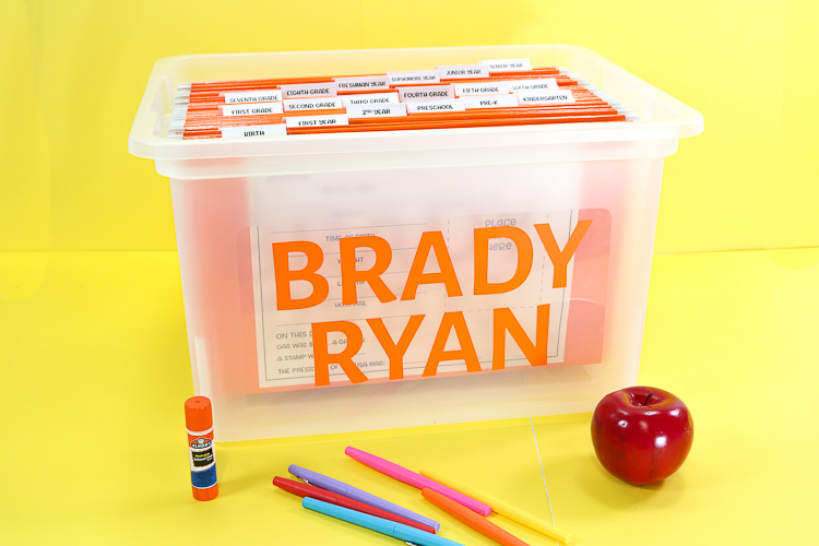 School Memory Bin with Name on outisde and a hanging folder for each year from birth through senior year.  Printables on front act as a timeline and folders hold keepsakes