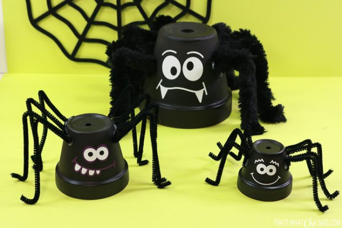 Three clay pots turned into spider decor