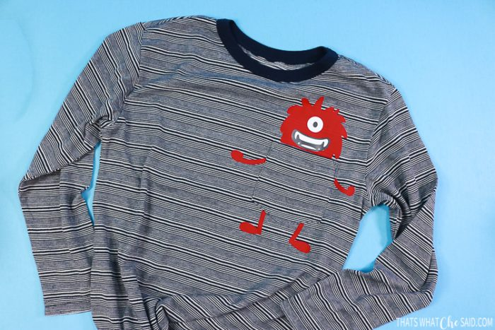 Boy's T-shirt with iron-on monster on the pocket