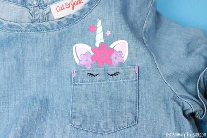 Denim girls shirt with unicorn peeking out of the pocket