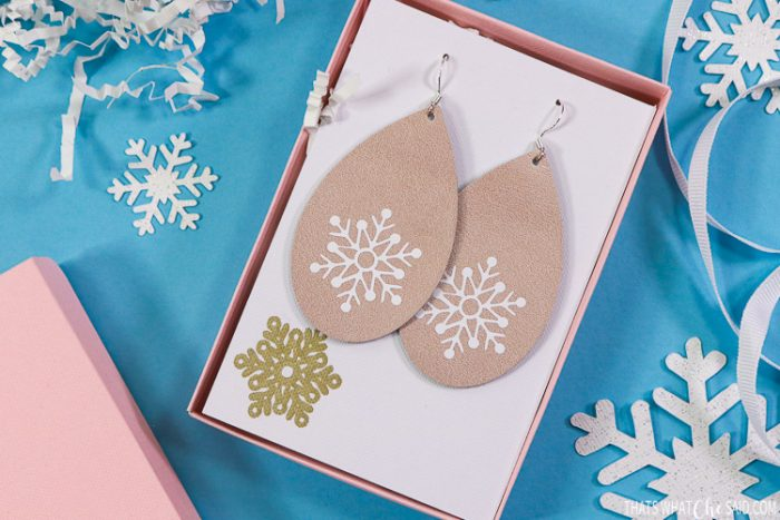 Rose Gold Leather Earrings cut with the Cricut Explore Air and Snowflakes Ironed on with white iron-on vinyl.