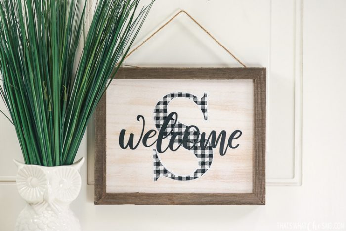 DIY welcome sign with adhesive vinyl and a personalized monogram
