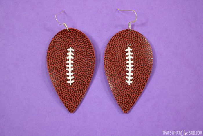 Reverse teardrop earrings cut in faux football leather