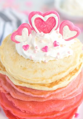 Pancakes stacked from red, dark pink,pink and white