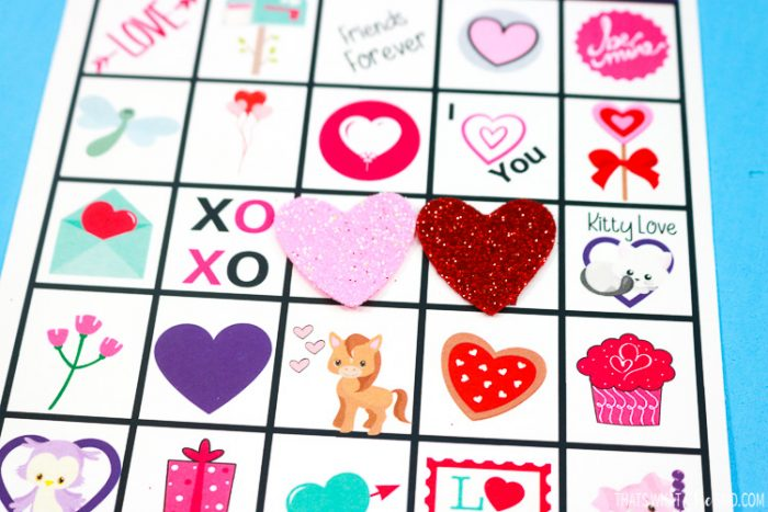 Close up of glitter foam heart bingo card markers