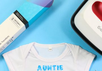 Cricut Infusible Ink baby bodysuit with a design from a transfer sheet - Aunties Stud Muffin