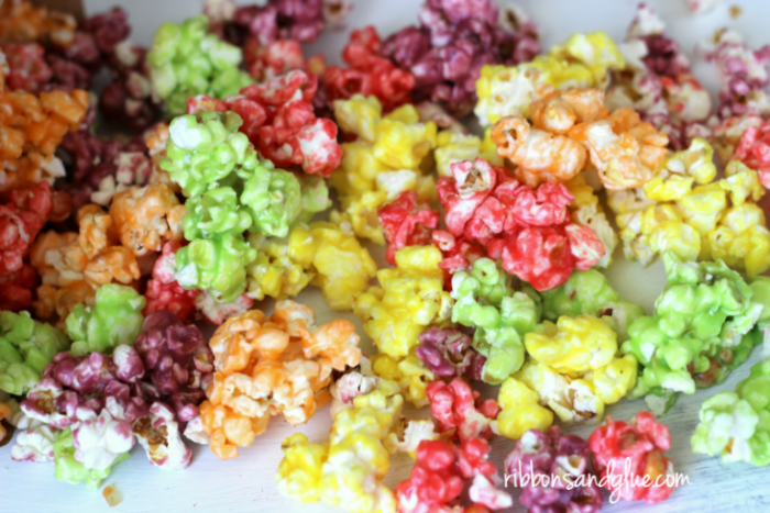 Popcorn with skittle candy coating in rainbow colors