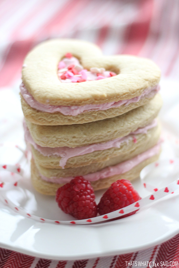 Stack of cookies showing raspberry filling