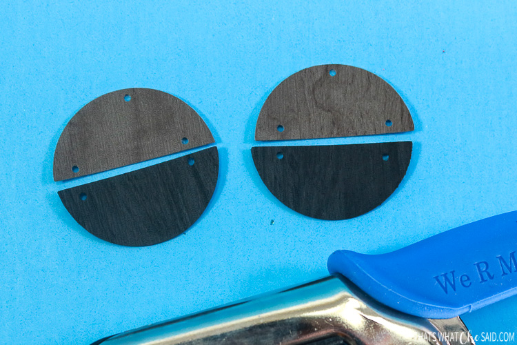 Close up of faux leather earrings with holes punched for jump rings and earring hooks