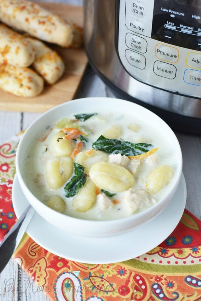 Gnocchi soup bowl with instant pot and breadsticks